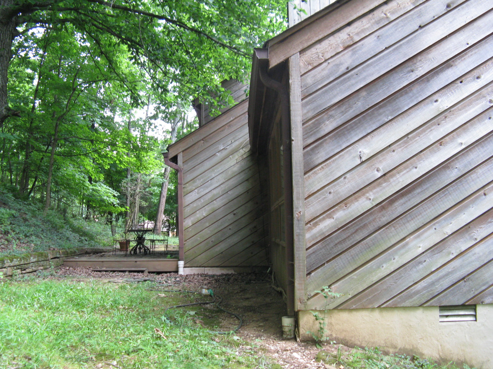 Replacing cedar siding modfrugal for Modern house siding solutions